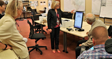 Lynda Roberts showing the Election Advisory Committee, Marin County's new accessible ballot marking device