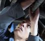 A young man works in an auto shop