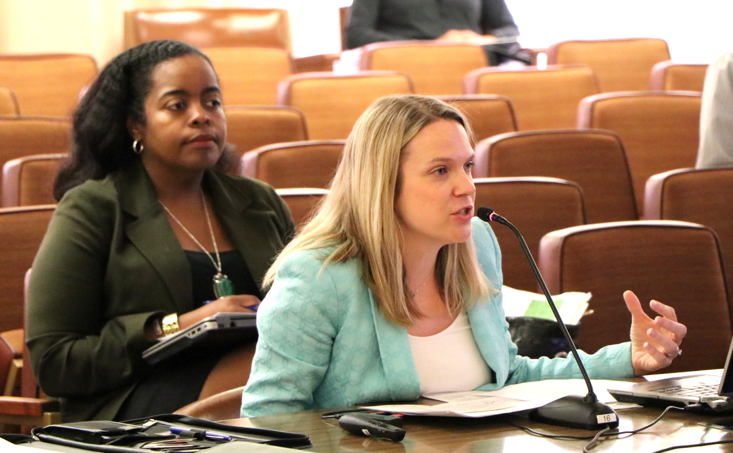 Chantel Walker of Human Resources (left) and Angela Nicholson of the County Administrator's Office present the equity package to the Supervisors.