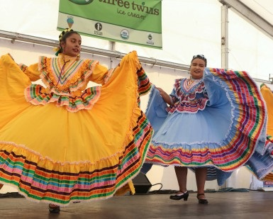 Two female dancers in traditional Mexican dresses perform at the Marin County Fair.
