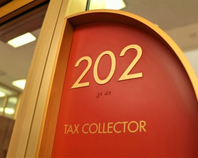 Sign saying Tax Collector, Suite 202