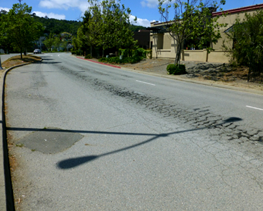 A close-up view of the deterioration on Donahue Street in Marin City.