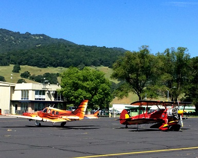 Two planes sit on a runway at Gnoss Field in Novato.
