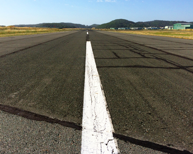 A closeup view of the pavement on the Gnoss Field runway