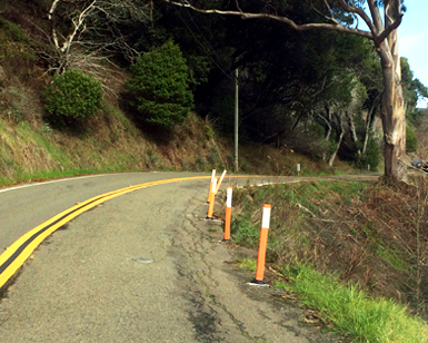 Roadside erosion is shown on a section of Muir Woods Road.
