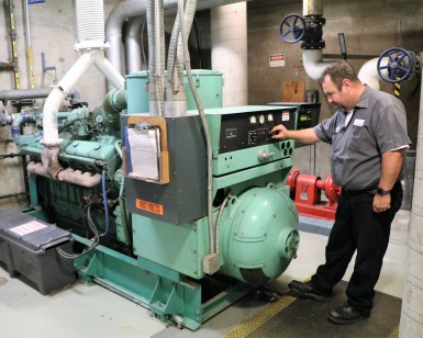 A building maintenance worker checks the diesel-powered generator at the Marin County Civic Center.