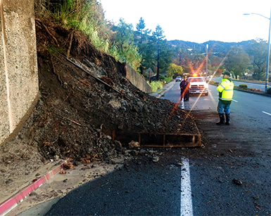 Workers check a mudslide on Point San Pedro Road.