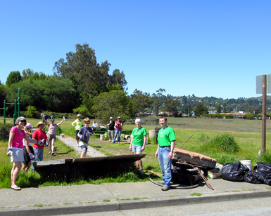 About 10 volunteers are shown at a past trash collection event.