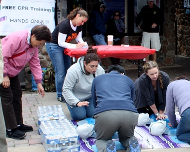 Several trainers help teach people how to do hands-only CPR at a past Don't Miss a Beat event.