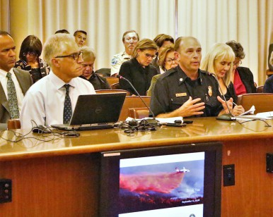 Chris Reilly (left), Emergency Services Manager for the Sheriff's Office, and Jason Weber (right), Marin County Fire Chief, speak at the Board of Supervisors meeting.
