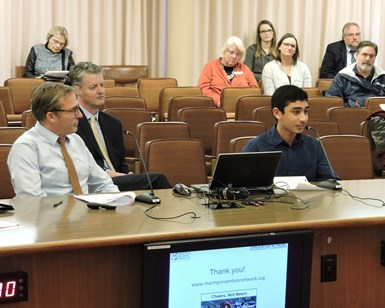 Joshua Rowe (right) of San Domenico School, a member of the Marin Prevention Network, speaks about the social host accountability ordinance at a Board of Supervisors meeting in December 2016 while Public Health Officer Dr. Matt Willis (left) looks on.