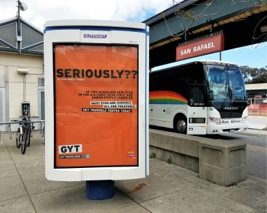 An advertising poster for STD Awareness Week is shown at the downtown San Rafael bus depot.