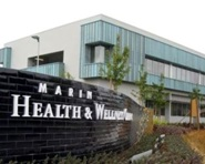 A view of the Marin Health and Wellness Center, with the sign in the foreground and building in the background.