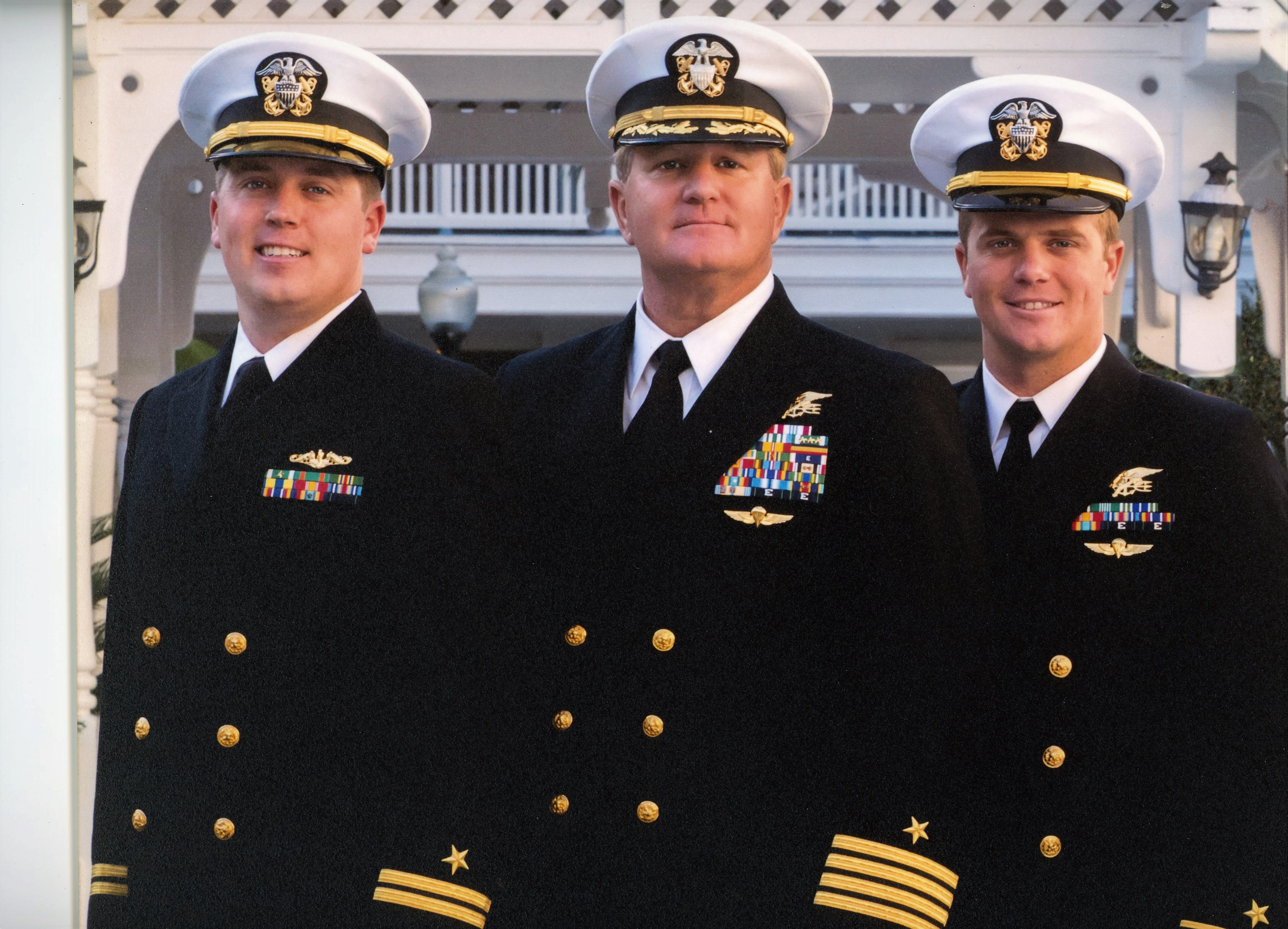 Retired Navy Captain Richard Sisk stands with his sons Brian and Sean, who are also in Navy uniforms.