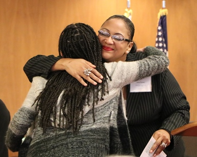 Marin County Human Rights Commissioner Gina Fromer gives a hug to San Rafael High School senior Miriam Amador, recipient of a Youth MLK Jr. Humanitarian Award from the commission.