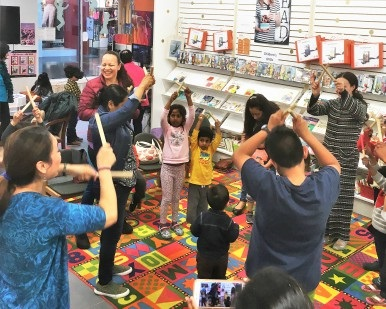 Several kids have fun during an activity inside the Northgate pop-up library branch.