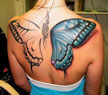 A lady with a butterfly tatoo on her back