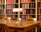 Library table with bookshelves in the background