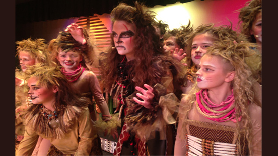 Katia and Company dancers dressed as various lion characters from the Lion King.