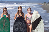 picture of 3 girls of skimboarding
