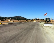Heavy equipment is shown smoothing out the Gnoss Field runway at the start of the renovation project in September.