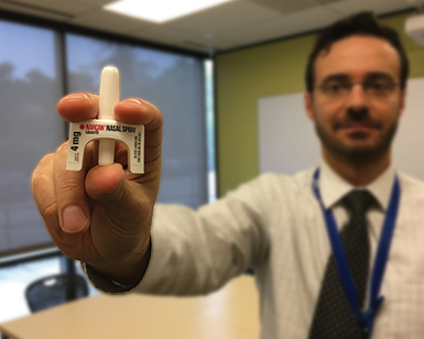 Dr. Jeff DeVido of Marin County Health and Human Services holds up an intranasal naloxone device.