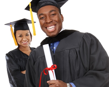 A young man and a young woman hold diplomas while wearing graduation gowns