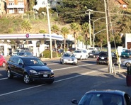 Cars and SUVs drive along Shoreline Highway in the busy Tam Junction area.